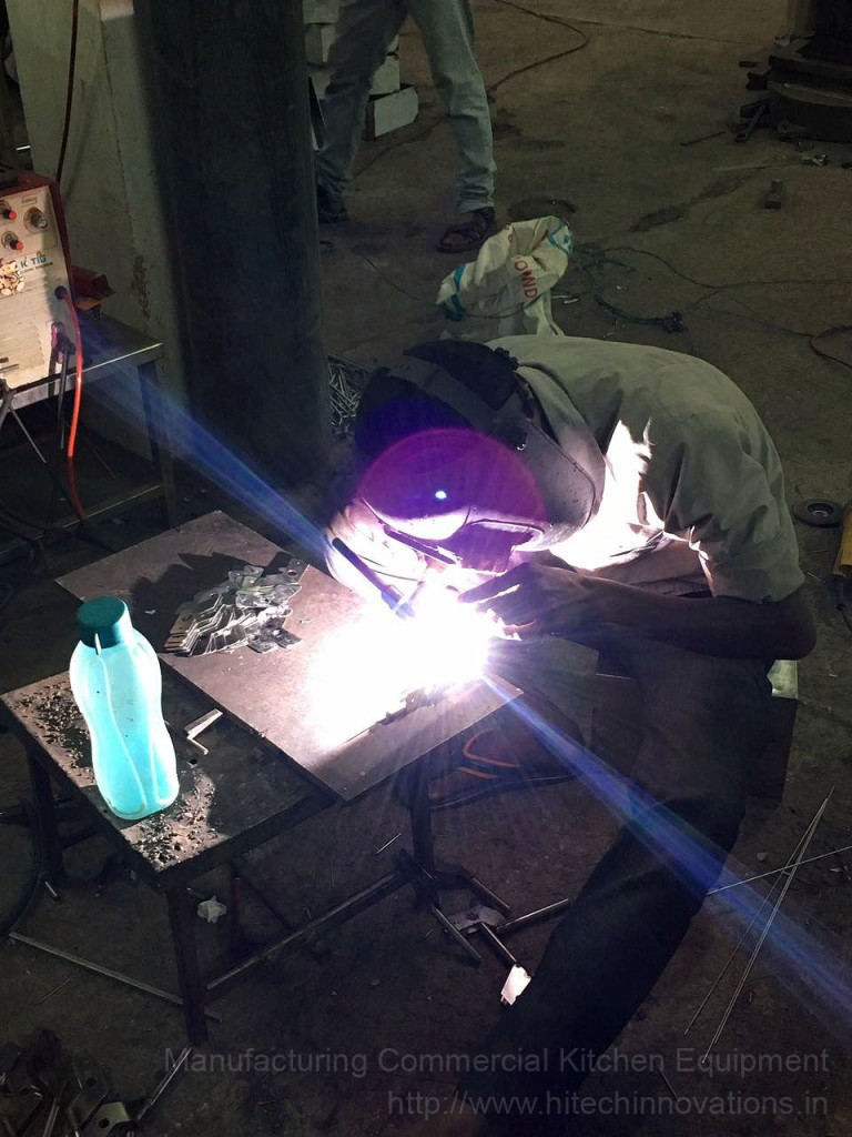 Stainless Steel Welder at Factory Manufacturing Commercial Kitchen Equipment